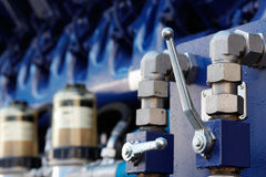 Pump with ball valves. The pump with ball valves on foreground. Selective focus Stock Photos