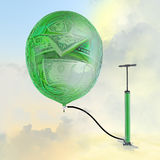 The pump, the balloon with the image of money. Stock Photos