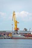 Pump-dredge ship under port crane Royalty Free Stock Photo