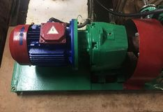 Pump and engine at an industrial facility. Caution the equipment in action. Details and close-up. Pump and engine at an industrial facility. Caution the stock image