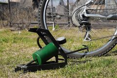 Pump for inflating bicycle tires. Royalty Free Stock Photo