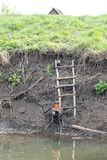The pump is installed on the Bank of the river for irrigation Royalty Free Stock Images