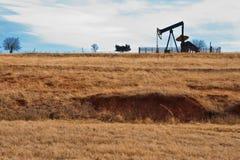 Pump Jack. Oil field pump jack against a cloudy sky Stock Images