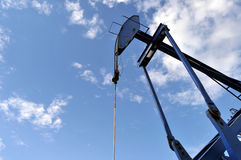 Pump jack against the sky Royalty Free Stock Photos