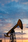 Pump jack extracts oil in Caucasus region Royalty Free Stock Images