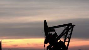 Pump Jack Fracking for Oil North Dakota Sunset Bakken stock video footage