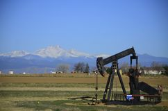 Pump Jack and Longs Peak Stock Images