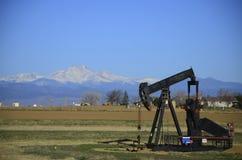 Pump Jack and Longs Peak stock images