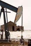 Pump jack near abandoned homestead. Saskatchewan Canada Stock Photography