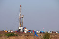 Pump jack and oil drilling rig Stock Photo