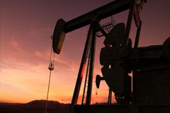 Pump jack in an oil field Stock Image