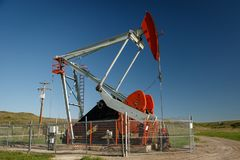 Pump jack on oil field in southern Alberta in Canada. Oil industry stock photo