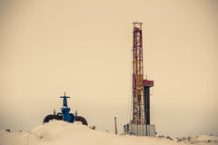 Pump jack and oil rig situated in forest. Stock Photography