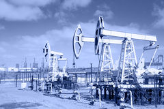 Pump jack on a oilfield. Stock Photo