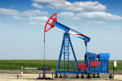 Pump jack on oilfield Stock Images
