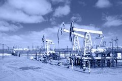 Pump jack on a oilfield. Toned. Royalty Free Stock Photos