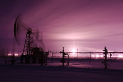 Pump jack and oilwell. Stock Image