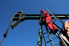 Oil Pump Jack Service Technician Royalty Free Stock Image