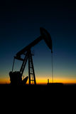 Pump jack silhouette Royalty Free Stock Photos
