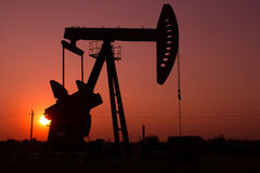 Pump jack silhouette Stock Photo
