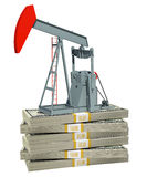 Pump jack on stack of money Stock Image