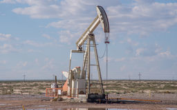 Pump jack in Texas. An oil pump jack in western Texas near Midland stock images