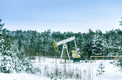 Pump jack and wellhead in the oilfield Stock Images