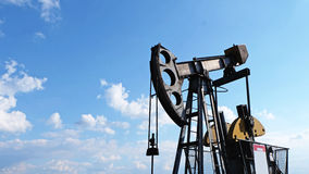 Pump jack and wellheads, Extraction of oil Royalty Free Stock Images