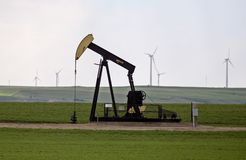 Pump Jack and wind farm Stock Photography