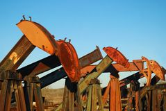 Pump Jack Yard. Pump jacks are for sale in a used equipment yard Royalty Free Stock Photo