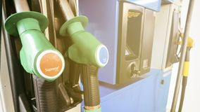 Pump nozzles for filling several gas at petrol station. Close up. Pump nozzles close-up for filling several gas at petrol station . Oil petrol energy. Outdoor stock images