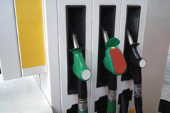 Pump nozzles. Nozzles of a fuel dispenser called bowser, petrol pump, or gas pump for refuelling vehicles or cars in a filling station, fuelling station, garage Stock Photo