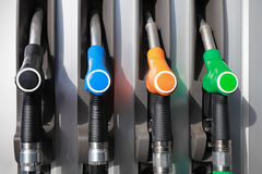 Pump nozzles in gas station Royalty Free Stock Image