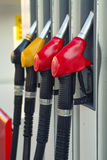 Pump nozzles at the gas station Royalty Free Stock Photos