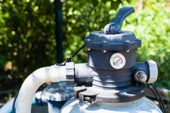 Pump Of Outdoor Filtering System Of Swimming Pool Stock Photo
