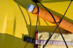 Pump and paddle float on deck of yellow sea kayak stock photography