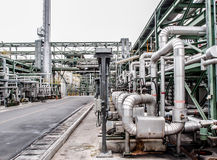 Pump station in oil refinery. With pipeline royalty free stock images