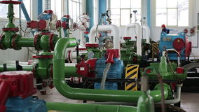 Pump station with pipes and valves stock footage