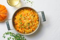 PumpaRisotto med timjan och parmesan, italiensk kokkonst arkivfoto