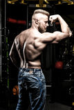 Pumped shirtless man in jeans at the gym royalty free stock photos