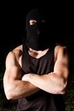 Pumped thug in black mask outdoors at night Royalty Free Stock Photos