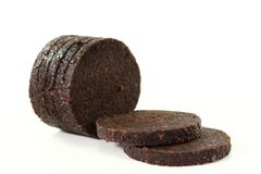 Pumpernickel. Some slices of pumpernickel bread on a white background Stock Photos