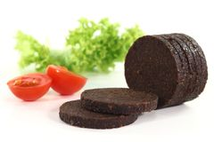 Pumpernickel. Some slices of pumpernickel bread on a white background royalty free stock image