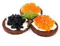 Pumpernickel bread with red and black caviar Stock Photography