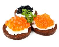 Pumpernickel bread with salmon, trout and sturgeon caviar Stock Images