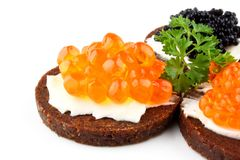 Pumpernickel bread topped with red caviar Royalty Free Stock Photo