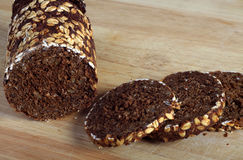Pumpernickel on a breadboard royalty free stock photography