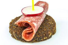 Pumpernickel with salami Stock Photography