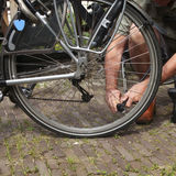 Pumping air in bike tire Royalty Free Stock Photo