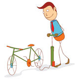 Pumping a bike wheel Stock Photo